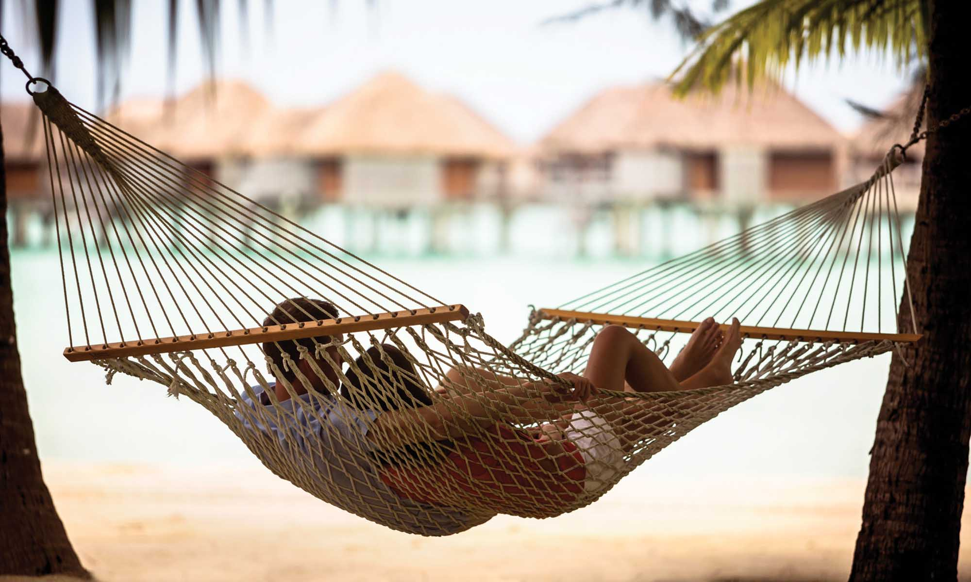 Four Seasons Resort Bora Bora, Romantic Couple in a Hammock