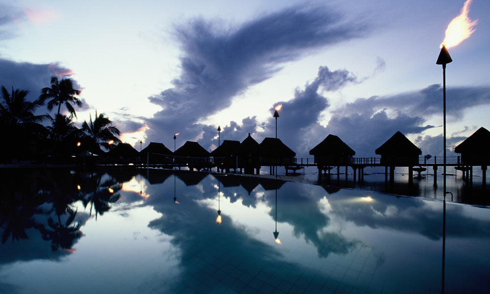Manava Beach Resort and Spa,  Overwater Bungalows at Dusk