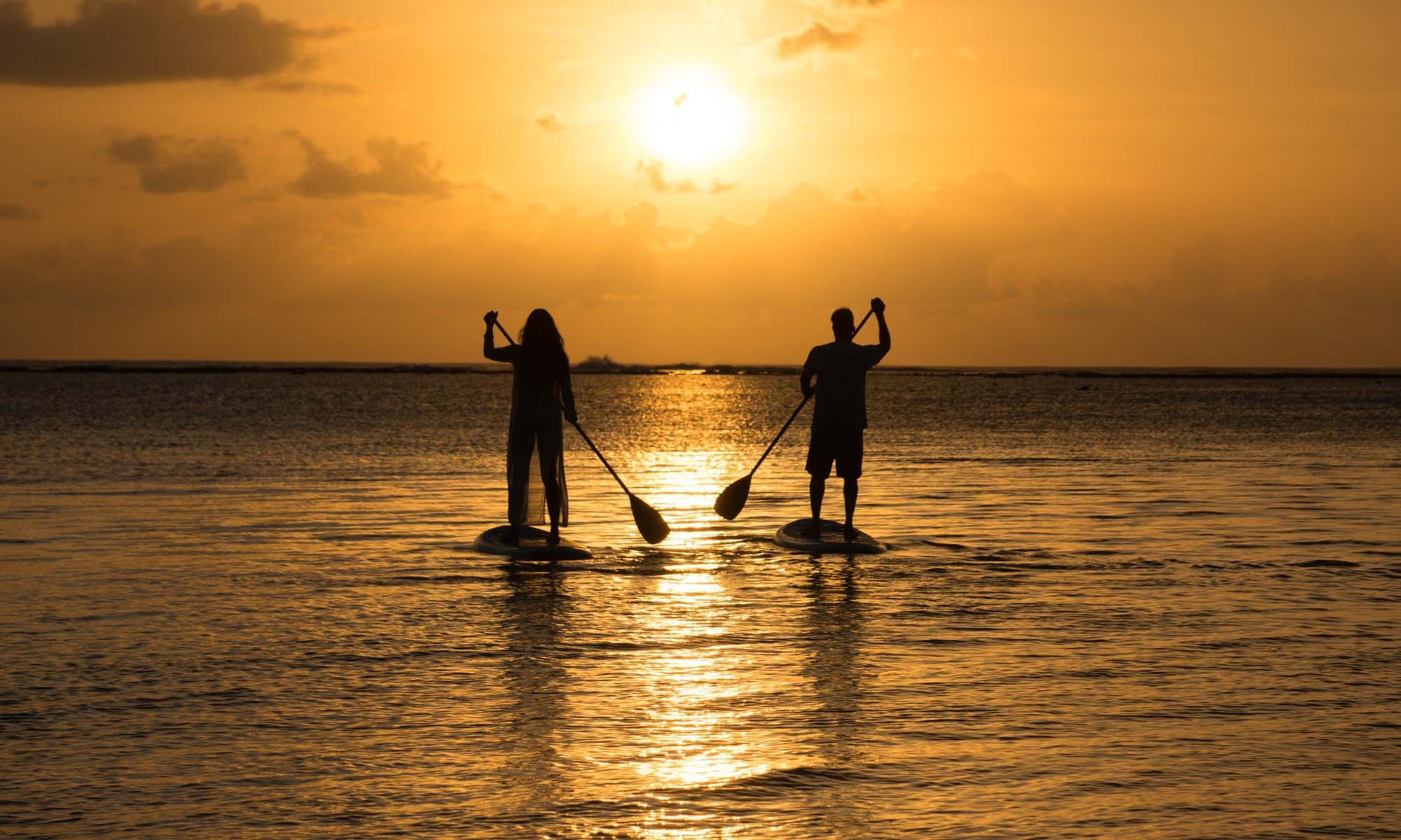 Ninamu Resort, Paddleboarding at Sunset