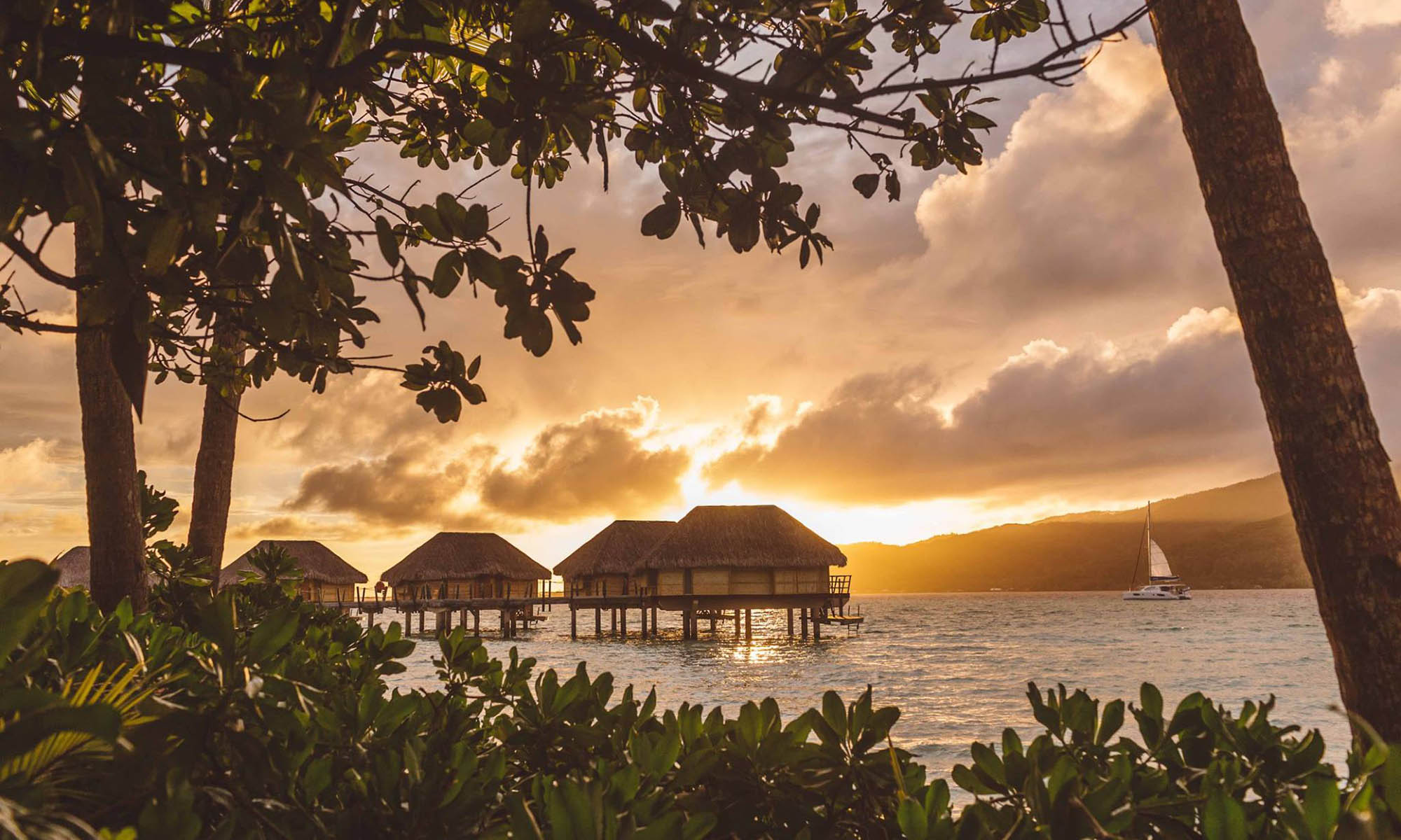 Le Taha'a Island Resort Overwater Bungalows at Sunset