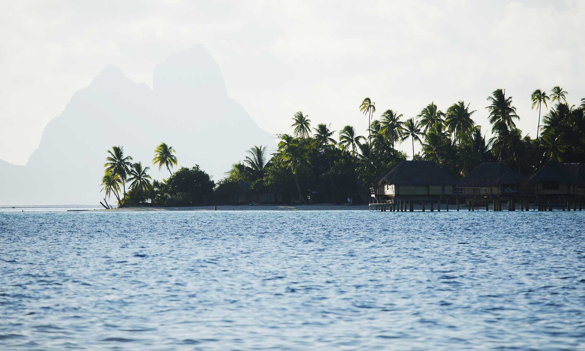Le Taha'a Island Resort Overwater Bungalows with Bora Bora's Mt Otemanu in the Distance