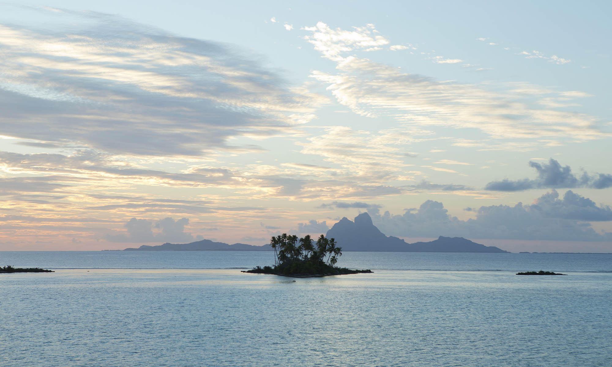 Taha'a Sunsets with Bora Bora in the Distance